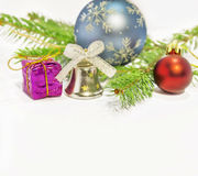 Several christmas decoration on green pine tree on white. Background stock images