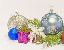 Several christmas decoration on green pine tree on white. Background royalty free stock image