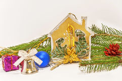 Several christmas decoration on green pine tree on white. Background royalty free stock photo