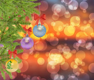 Several christmas decorative ball with bow and pine tree on boke Royalty Free Stock Photos