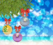 Several christmas decorative ball with bow and pine tree. On bokeh background stock image