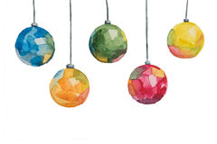 Several Christmas multi-colored balls painted with watercolors hanging on threads on a white background Royalty Free Stock Image
