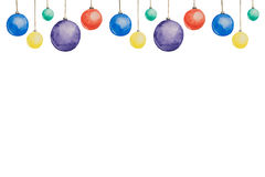 Several Christmas multi-colored balls painted with watercolors hanging on threads on a white background Stock Images