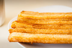 Several churros on small plate Royalty Free Stock Photo