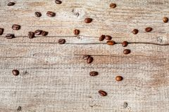 Several coffee beans on the old board stock images