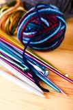 Several color knitting needles with balls of wool Royalty Free Stock Photos