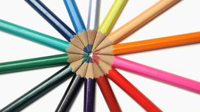 Several color pencils joined at the top rotating stock footage