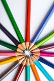 Several color pencils on a white paper sheet Royalty Free Stock Photo