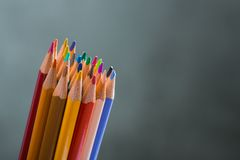 Several color pencils on a white paper sheet Stock Photography