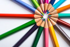 Several color pencils on a white paper sheet Royalty Free Stock Image