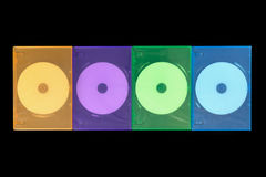 Several colored boxes DVD / CD on black background royalty free stock photo
