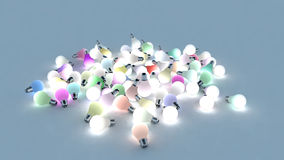 Several colored light bulbs on the ground. 3D Rendering Stock Images