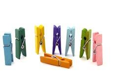 Several colored linen pegs vertically  Stock Photos