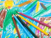 Several colored pencils on children draw picture Royalty Free Stock Image