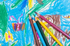 Several colored pencils on children picture Stock Photo