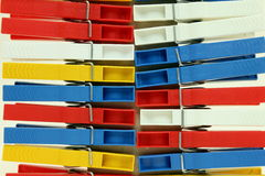 Several colored plastic clothespins. For a bright background Stock Image