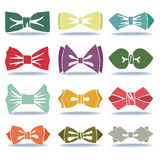 Several colored silhouettes of bow tie with shadow Royalty Free Stock Images