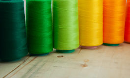 Several of colored spools of thread for sewing and embroidery Stock Image