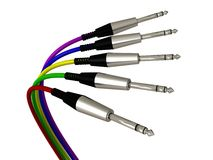 Several colored wires with jack plugs. Several colored wires with shiny jack plugs Stock Photography
