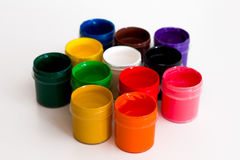 Several colorful open jars of gouache stock photography