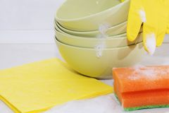 Several colorful plates, kitchen sponges. Royalty Free Stock Image