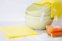 Several colorful plates, kitchen sponges. Royalty Free Stock Images