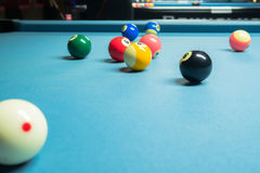 Several colorful pool balls on the pool table stock image