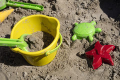 Several colorful sand toys as bucket, turtle, spade and starfish Stock Photography