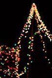 Several colors of blurry lights decorated all over a Christmas tree. royalty free stock photography