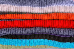 Several colors pullovers stack Royalty Free Stock Image