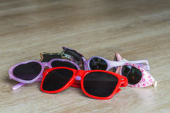 Several colors of sunglasses with heart-shaped and star-shaped Stock Photo
