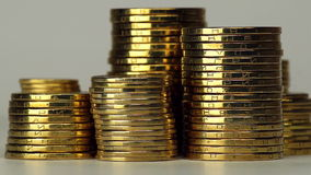 Several Columns of Coins Spinning stock video footage