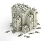 Several columns of dollars money packs. And scattered bills Stock Photo