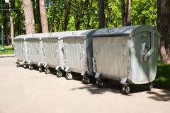 Several containers of trash on an asphalt site Royalty Free Stock Photo