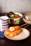 Several corndogs on a plate Royalty Free Stock Photos