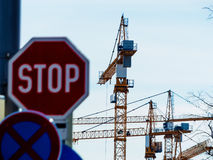 Several cranes on construction site Stock Photo
