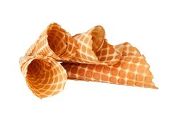 Several empty crispy ice-cream waffle cones on white background isolated closeup top view royalty free stock image