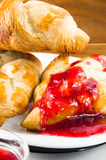 Several croissants smeared with strawberry jam Stock Photography