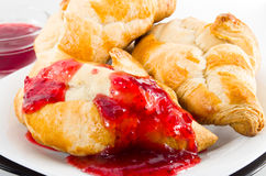 Several croissants smeared with strawberry jam Royalty Free Stock Photos
