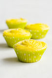 Several cupcakes with yellow cream Royalty Free Stock Images
