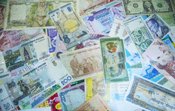 Several currency banknotes background. Background view of currency notes of various countries Royalty Free Stock Images