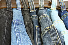 Several denim pants Stock Image