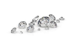 Several diamonds. Several diamonds on a white background. Focus on the largest stone Royalty Free Stock Photo