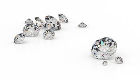 Several diamonds. Of various sizes on a white background Royalty Free Stock Photos