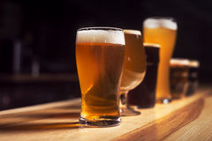 Several different beers are standing in a row. At the bar Royalty Free Stock Images