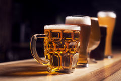 Several different beers are standing in a row. At the bar Royalty Free Stock Image