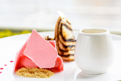 Several different desserts ice cream, pies and meringues lie o stock photos