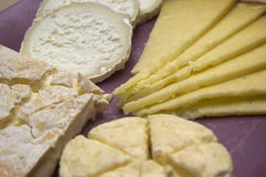 Several different French cheeses on a plate Royalty Free Stock Photos