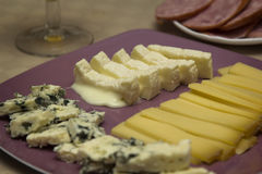 Several different French cheeses on a plate Stock Photos
