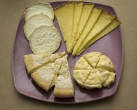 Several different French cheeses on a plate Royalty Free Stock Photo